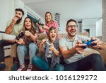 group of friends play video... | Shutterstock . vector #1016129272