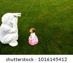 easter bunny playing peep bo... | Shutterstock . vector #1016145412