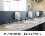 public restroom with sinks... | Shutterstock . vector #1016149042