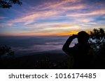 silhouette man taking photo of...   Shutterstock . vector #1016174485