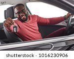 happy handsome african man... | Shutterstock . vector #1016230906