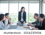 a group of businessmen during a ... | Shutterstock . vector #1016235436