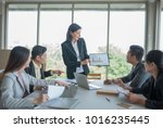 a group of business people... | Shutterstock . vector #1016235445