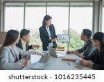 a group of businessmen meeting... | Shutterstock . vector #1016235445