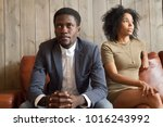 frustrated upset african couple ... | Shutterstock . vector #1016243992