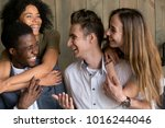 two happy african and caucasian ... | Shutterstock . vector #1016244046