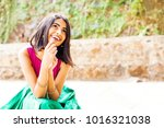 beautiful indian woman thinking ... | Shutterstock . vector #1016321038