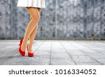woman legs with red shoes and... | Shutterstock . vector #1016334052