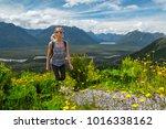 woman hiker walks in the... | Shutterstock . vector #1016338162