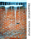 icicles hanging from the roof...   Shutterstock . vector #1016349982