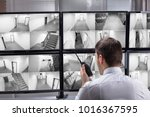 young male security guard... | Shutterstock . vector #1016367595