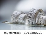 curved measuring tape.... | Shutterstock . vector #1016380222