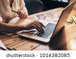 close up of young woman working ... | Shutterstock . vector #1016382085