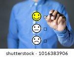 businessman hand putting check... | Shutterstock . vector #1016383906