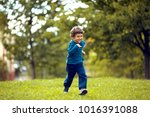 Cute Boy Running Across Grass...
