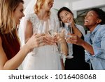 woman in bridal gown toasting... | Shutterstock . vector #1016408068