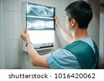 veterinarian looks at the x ray ... | Shutterstock . vector #1016420062