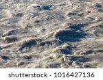 rapids stream of a muddy river...   Shutterstock . vector #1016427136