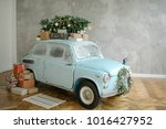 blue retro car with christmas...   Shutterstock . vector #1016427952