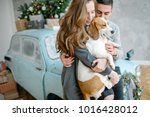 young couple with beagle and...   Shutterstock . vector #1016428012