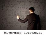 young businessman in black suit ... | Shutterstock . vector #1016428282