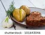 Roast beef steak served with potatoes and dill - stock photo