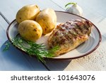 Roasted chicken served with potatoes and dill - stock photo