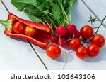 Fresh vegetables on an old weathered plank - stock photo