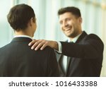 the happy businessmen pat on... | Shutterstock . vector #1016433388