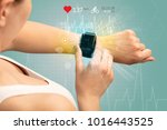 hand with smartwatch and... | Shutterstock . vector #1016443525