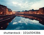view of river arno at dusk with ... | Shutterstock . vector #1016504386
