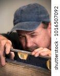 closeup of male carpenter using ... | Shutterstock . vector #1016507092