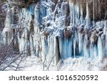 big icicle  spring water and... | Shutterstock . vector #1016520592