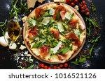 salmon and arugula pizza. light ... | Shutterstock . vector #1016521126