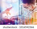 double exposure of scientist or ... | Shutterstock . vector #1016542366
