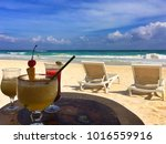 three cocktails on the beach in ... | Shutterstock . vector #1016559916