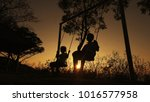 silhouetted children boy and... | Shutterstock . vector #1016577958