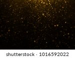 abstract gold bokeh with black... | Shutterstock . vector #1016592022
