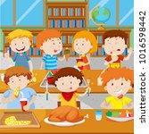school children having lunch in ... | Shutterstock .eps vector #1016598442