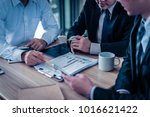 three businessman sitting and... | Shutterstock . vector #1016621422