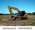 new excavator in new... | Shutterstock . vector #1016634832
