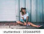 fashionista girl sitting in the ... | Shutterstock . vector #1016666905