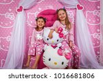 two girls in pajamas and with... | Shutterstock . vector #1016681806