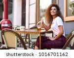 young arabic woman smiling and... | Shutterstock . vector #1016701162