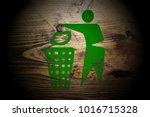 green recycle sign painted on... | Shutterstock . vector #1016715328