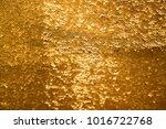Golden And Iridescent Sequins...