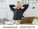 successful businessman sitting... | Shutterstock . vector #1016723176