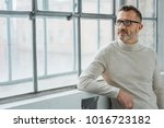 thoughtful man wearing glasses... | Shutterstock . vector #1016723182