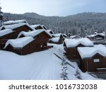 Small photo of Wooden chalets of the ski resort La Tania Courchevel with lots of snow on the roofs