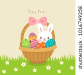 easter basket with colorful... | Shutterstock .eps vector #1016749258